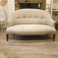 Small french vintage tub sofa covered in Taupe linen, with sabre brown legs. C1950