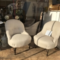 Pair of French slipper chairs covered in Taupe linen with a buttoned back, beechwood turned legs. Pre War.